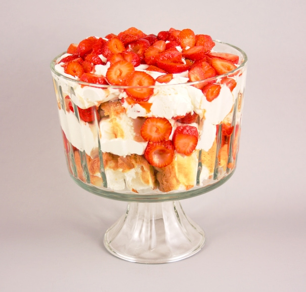 This is a photo of a strawberries, angel food cake and whipped cream trifle.