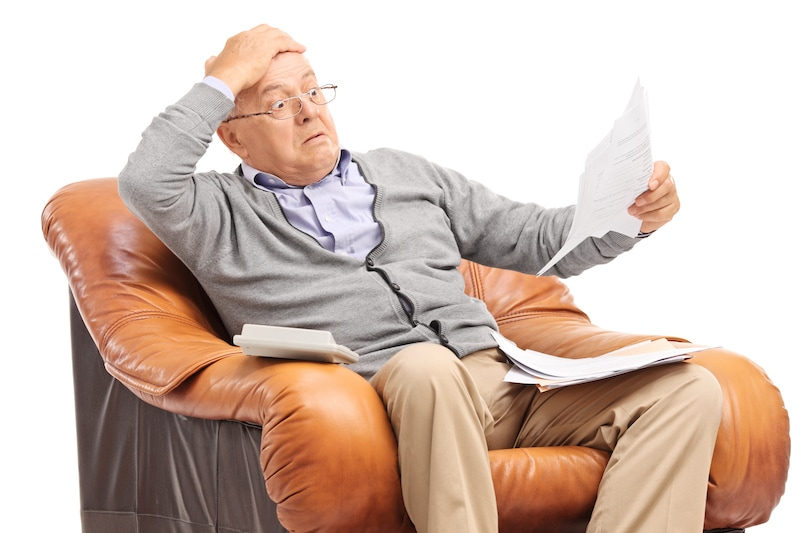 Shocked senior man looking at his bills in disbelief, Have You Utility Bills Jumped?